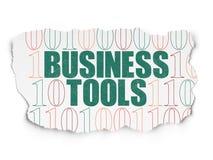 企业概念:在被撕毁的纸的企业工具 免版税图库摄影