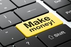 企业概念:挣金钱!在键盘背景 免版税库存照片