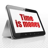 企业概念:有时间的片剂计算机是在显示的金钱 库存图片