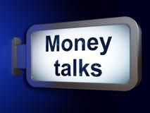 企业概念:金钱在广告牌背景谈话 免版税库存图片