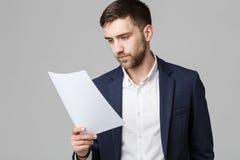 企业概念-一个英俊的商人的画象在衣服的与玻璃严肃认为与紧张表情 Isol 库存照片