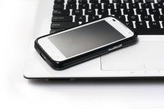 笔记本和smartphone 库存图片