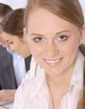企业特写镜头微笑的妇女年轻人 免版税库存照片