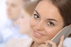 企业特写镜头微笑的妇女年轻人 库存照片