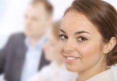 企业特写镜头微笑的妇女年轻人 图库摄影