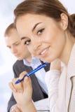 企业特写镜头微笑的妇女年轻人 库存图片