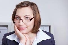企业玻璃微笑的妇女 库存图片