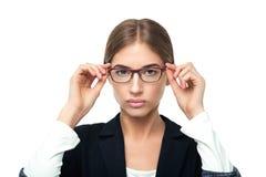 企业玻璃看起来严重的佩带的妇女 免版税库存照片