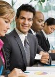 企业生意人看板卡提供 免版税图库摄影