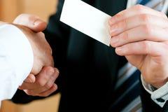 企业生意人看板卡移交 免版税库存图片