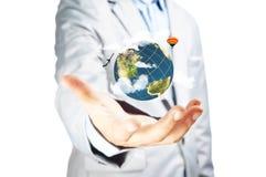企业男性手举行地球地球 库存照片