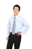 企业确信的人微笑年轻人 免版税库存图片
