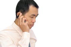 企业移动电话人成熟使用 图库摄影