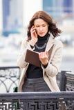 企业移动电话联系的妇女 图库摄影