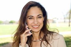 企业移动电话联系的妇女 库存照片