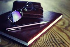 企业笔玻璃笔记本 免版税库存照片