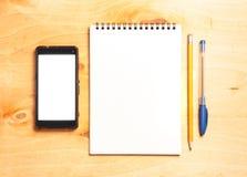 企业精华 螺旋空白的笔记本顶视图  库存图片