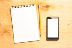 企业精华 螺旋空白的笔记本顶视图  免版税图库摄影