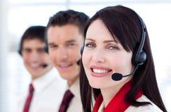 企业耳机微笑的小组 免版税图库摄影