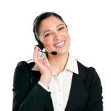 企业耳机运算符微笑的妇女 免版税库存图片