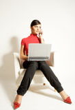 企业膝上型计算机电话妇女 库存照片