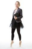企业芭蕾舞女演员和书 免版税库存照片