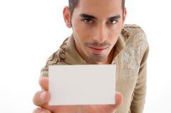 企业英俊生意人的看板卡他的陈列 免版税图库摄影