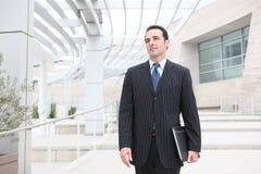 企业英俊的人办公室 免版税库存图片