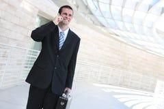 企业英俊的人电话 库存照片