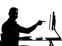 企业计算机人一指向的剪影 免版税库存图片