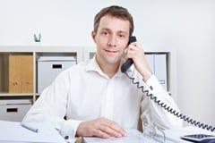 企业购买权人电话接受 免版税库存照片