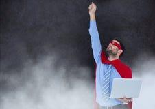 企业超级英雄对有云彩的石墙 免版税库存图片