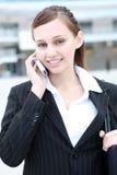 企业逗人喜爱的电话妇女 库存照片