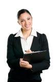 企业采取妇女的剪贴板附注 图库摄影