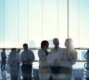 企业队会议讨论证券交易经纪人行情室概念 免版税库存照片