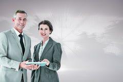 企业队的综合图象使用片剂个人计算机的 免版税库存照片