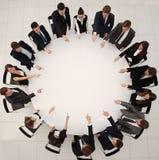 企业队表明圆桌的中心 图库摄影