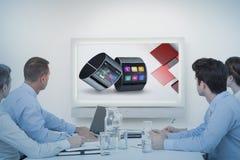 企业队观看的whiteboard的综合图象在会议期间 图库摄影