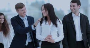 企业队:同事互相沟通在  库存照片