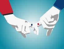 企业man& x27; 带淡红色s的手显示或小指代表 免版税库存照片