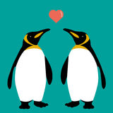 企鹅夫妇爱逗人喜爱心脏的家庭 库存图片
