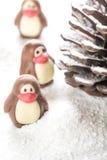 以企鹅的形式巧克力糖 免版税库存图片