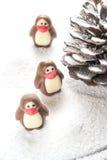 以企鹅的形式巧克力糖 库存照片