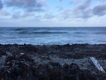 休息风雨如磐的岸  库存图片