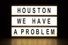 休斯敦我们有一个问题灯箱标志板 免版税库存照片