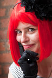 优等的朝向的红色妇女年轻人 免版税库存照片