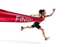 优胜者在终点线的妇女赛跑者 库存图片