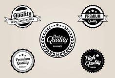 优质质量&保证标签和徽章-减速火箭的葡萄酒样式 免版税库存图片