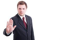 会计或商人陈列中止和逗留打手势 免版税库存图片