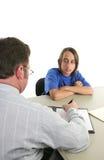 会议严重的实习教师 免版税库存照片